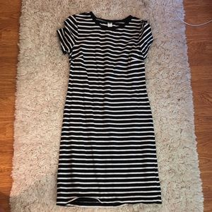 Black and white striped, tight dress.